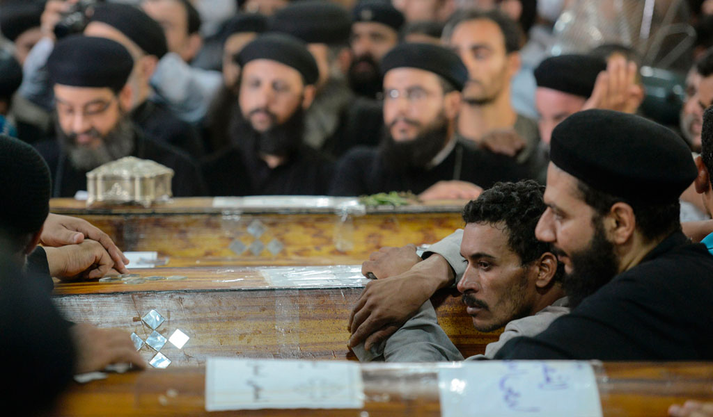 Coptic Christians mourn the victims of the caravan attack