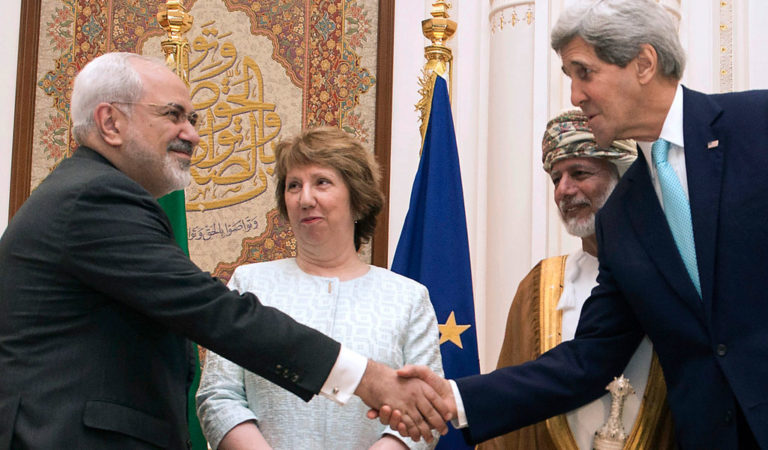 U.S. Secretary of State John Kerry (R) and Iranian Foreign Minister Javad Zarif (L) shake hands as Omani Foreign Minister Yussef bin Alawi (2nd R) and EU envoy Catherine Ashton watch in Muscat November 9, 2014.