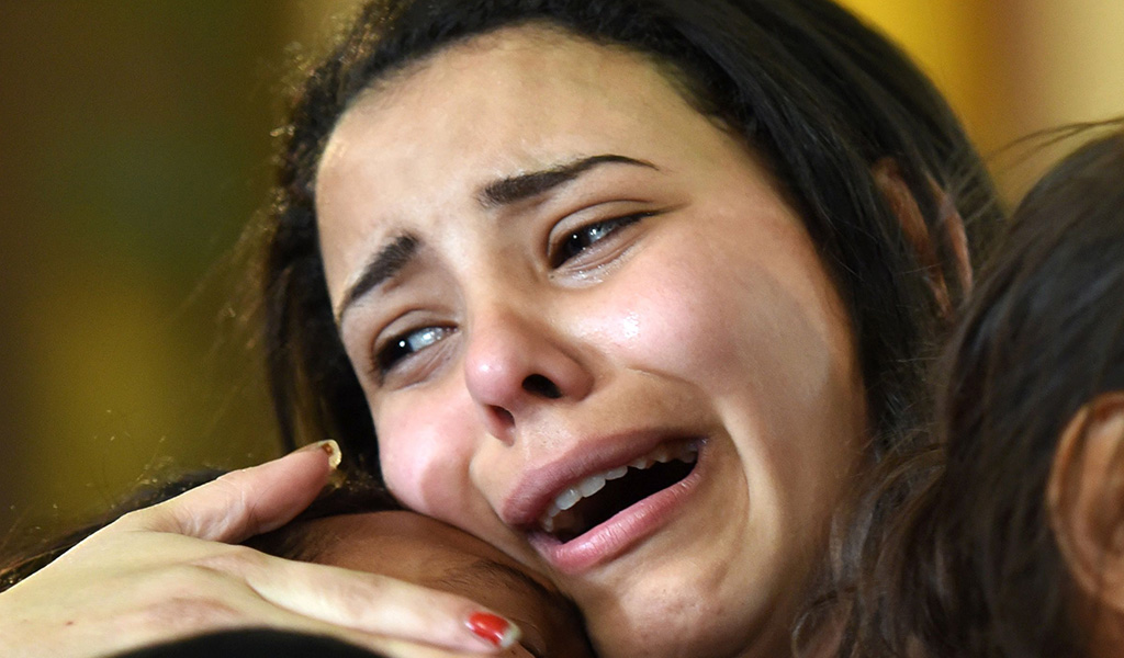 A young women mourns for the victims of the blast at the Coptic Christian Saint Mark's church in Alexandria