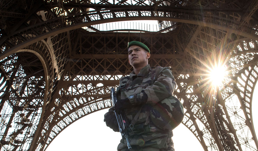 A soldier stand guard under the Paris' iconic Eiffel Tower after an Islamic attack