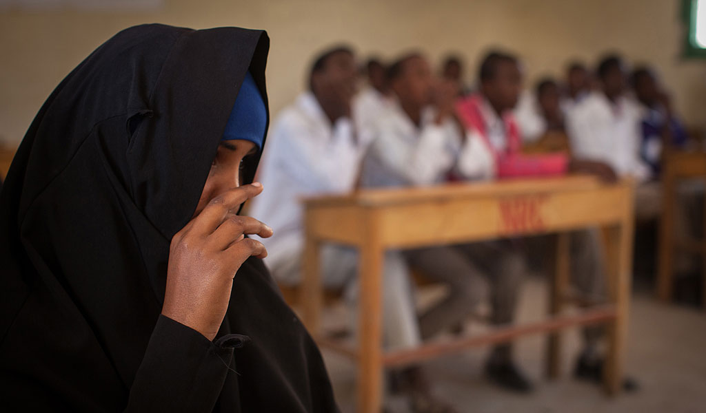 A woman participates in a discussion about FGM in Somalia