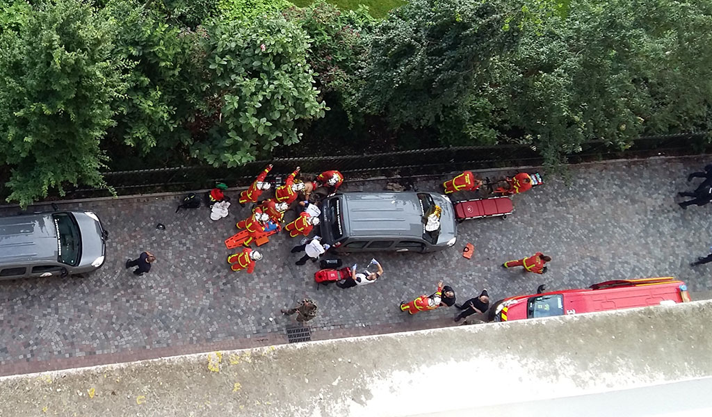 Officials and rescuers gather near vehicles after a car slammed into soldiers on patrol in Levallois-Perret, outside Paris on August 9, 2017 injuring six, two of them seriously.