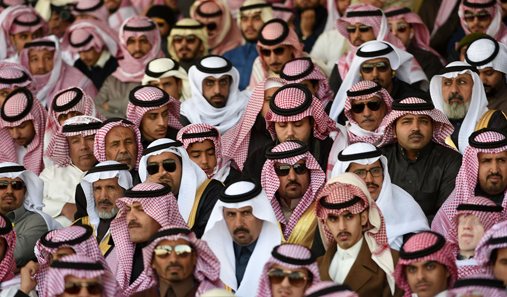 Saudis attend a ceremony marking the 50th anniversary of the creation of the King Faisal Air Academy at King Salman airbase in Riyadh.