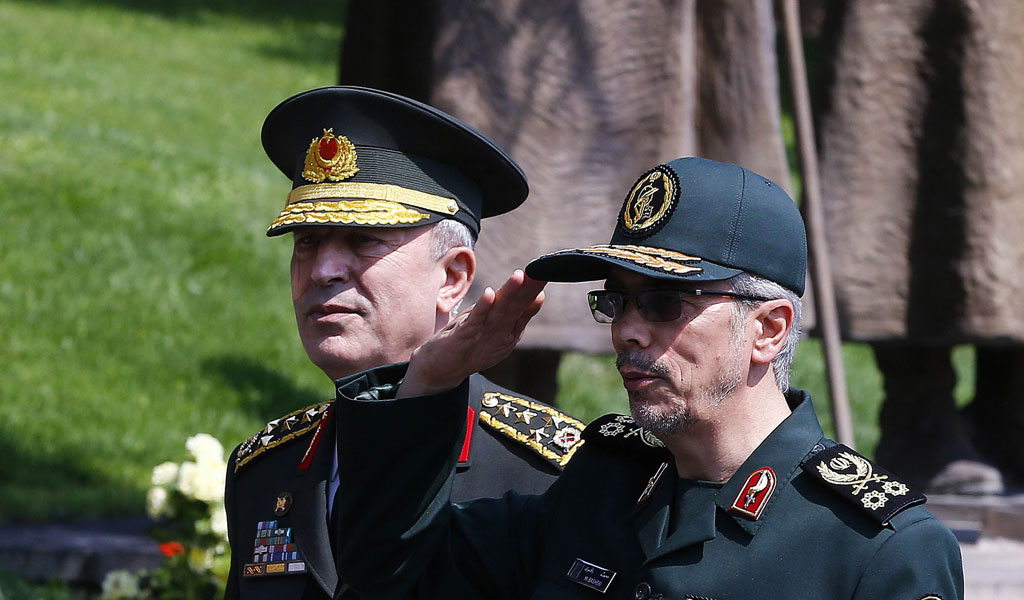Military Chief of Staff of the Armed Forces of Iran, Mohammad Bagheri (R) salutes the honor guards as he is welcomed by his Turkish counterpart Hulusi Akar (L) during his official visit at the Turkish General Staff headquarters in Ankara, on August 15, 2017.
