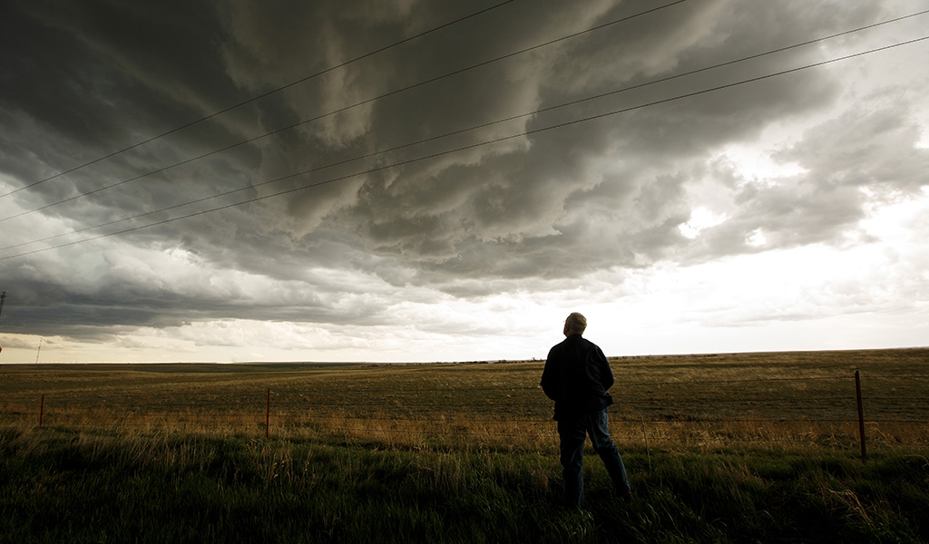 Tim Marshall, a 40 year veteran of storm chasing, monitors a supercell thunderstorm during a tornado research mission, May 8, 2017 in Elbert County near Agate, Colorado. (Photo: Drew Angerer / Getty Images)