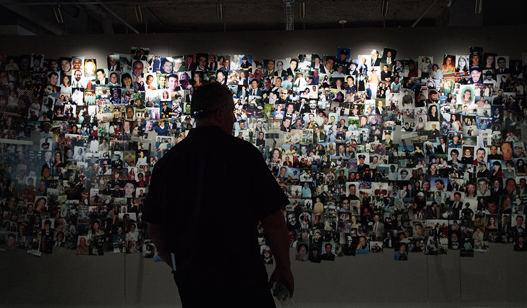 A man views photographs of victims in the new 9/11 Tribute Museum, June 13, 2017 in New York City.