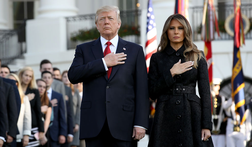 U.S. President Donald Trump and First Lady Melania Trump with the White House staff at a memorial ceremony for those killed in the 9/11 terror attacks.