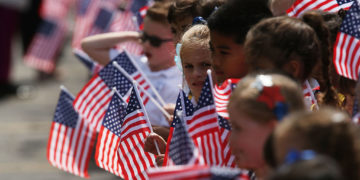 Local school children attend the funeral of retired FDNY firefighter Ray Pfeifer on June 2, 2017 in Hicksville, New York. Pfeifer, 59, fought a years-long battle with cancer attributed to his work at Ground Zero after the 9/11 terrorist attacks. The 27-year FDNY veteran spent about eight months working on the pile site of debris in lower Manhattan and was instrumental in getting lawmakers to pass the James L. Zadroga 9/11 Health & Compensation Act.