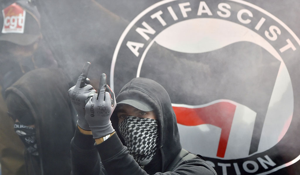 An anti-fascist protester in France demonstrates against labor reforms