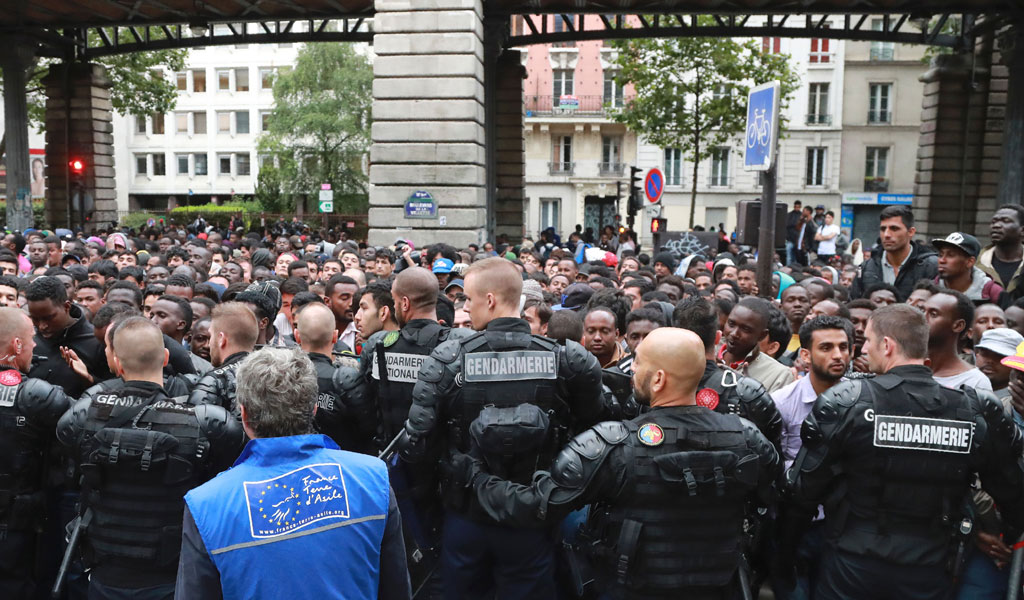 Illegal immigrants, mostly men from Somalia, Eritrea and Afghanistan protest in Paris