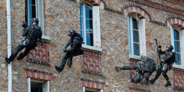 French police take place in a drill simulating a hostage taking