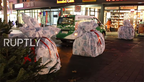 Concrete barriers in Germany made to look like holiday gifts.