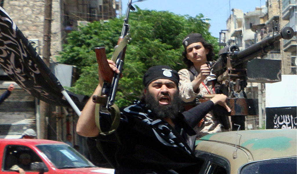 Fighters from al-Qaeda's affiliate in Syria, Jabhat al-Nusra, celebrate as they gain control of the eastern part of Aleppo in 2015. The terrori group was being helped by both Assad and Iran.