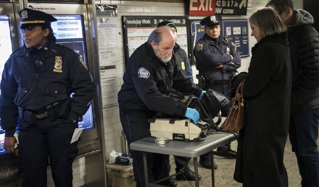 Police check bags at Time Square station. (Photo: Drew Angerer/Getty Images)