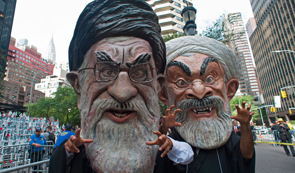Protesters dressed as Iran's Supreme Leader Ali Khamenei (L ) and Iran's President Hassan Rouhani Iranian Americans in support of the National Resistance of Iran at a rally near the UN in New York