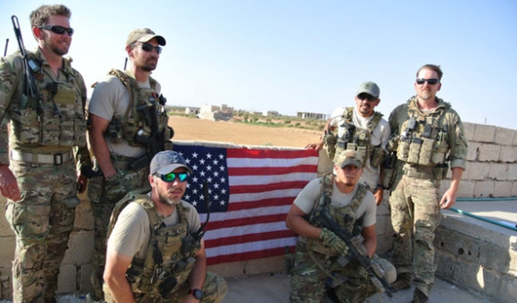 The Special Operations Surgical Team during a reenlistment. Standing at back, left to right, emergency medicine physician Lt. Col. Ben Mitchell, emergency room nurse Capt. Cade Reedy, emergency room nurse Maj. Nelson Pacheco, nurse anesthetist Lt. Col. Matthew Uber. Kneeling, surgeon Maj. Justin Manley, left, and respiratory therapist Tech. Sgt. Richard Holguin, right. (Photo: Air Force)