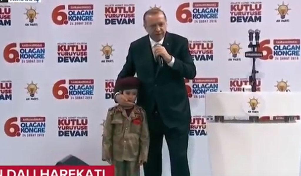 Turkish President Erdogan with the child on stage