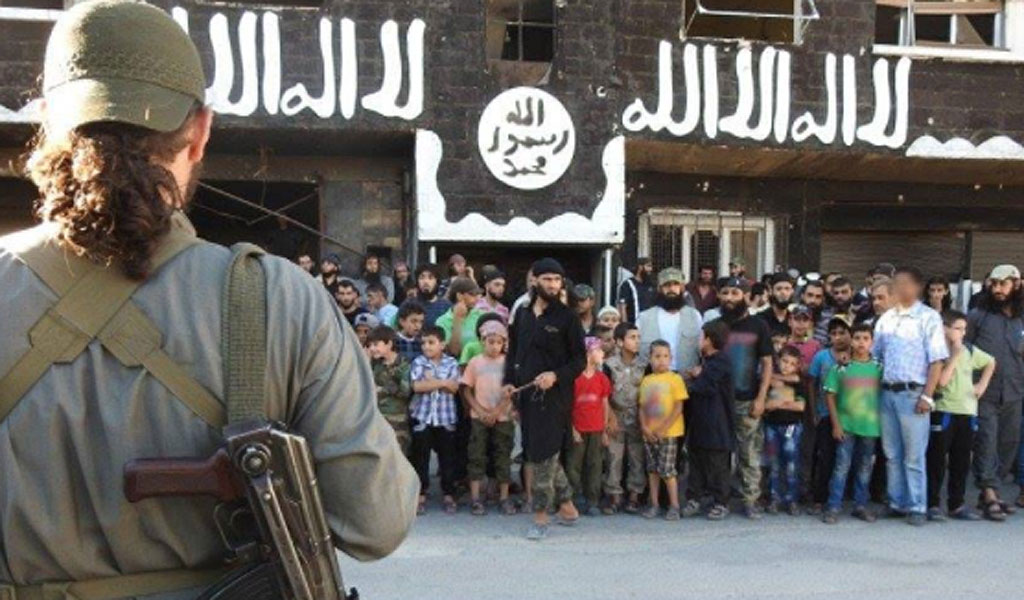 ISIS gathers the public in the main square of Al-Shajara for the stone and whipping