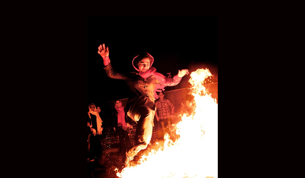 An Iranian woman marks the Persian Fire Festival holiday.