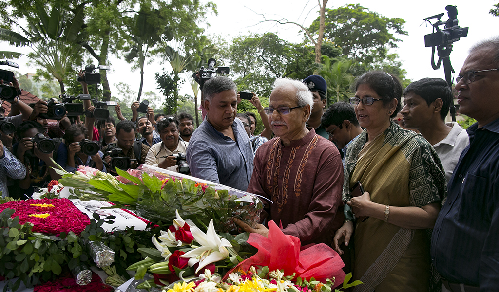 People visit a memorial at the former location of Holey Artisan Bakery on the one year anniversary of the cafe attack on July 1, 2017 in Dhaka, Bangladesh. On July 1, 2016 a brutal attack claimed by Islamic State killed 18 foreigners and four Bangladeshis at Holey Artisan Bakery. They then held staff and patrons hostage for 10 hours.