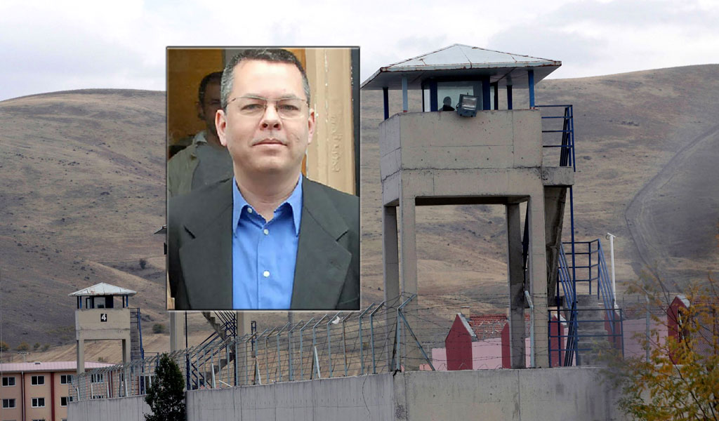 Pastor Andrew Brunson [Inset photo: STR/AFP/Getty Images; Background photo: a prison in Turkey (Adem Altan/AFP/Getty Images)]