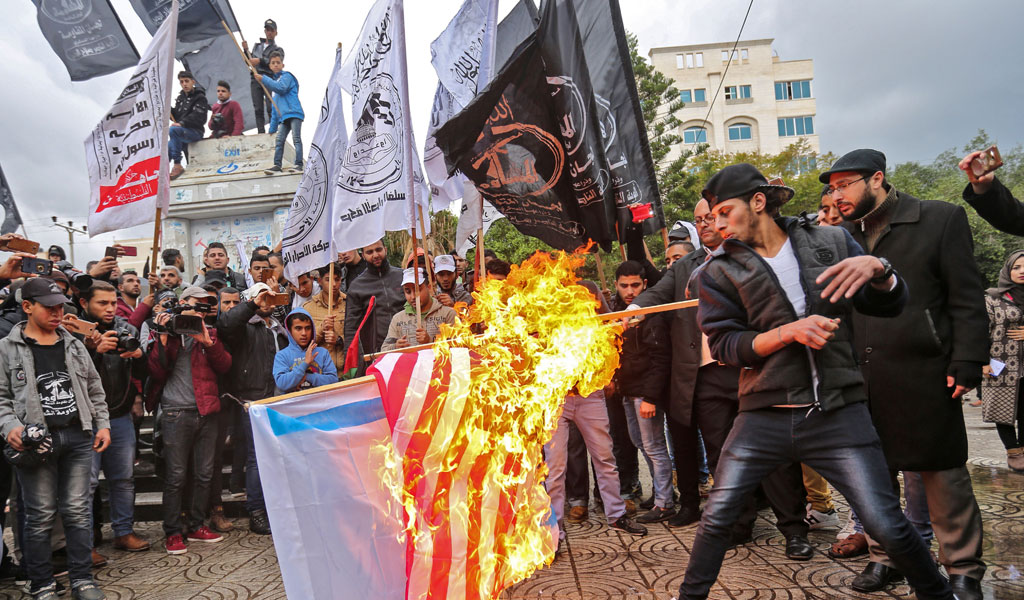 Palestinians protest the U.S.'s decision to recognize Jerusalem as the capital of Israel (Photo: MAHMUD HAMS/AFP/Getty Images)