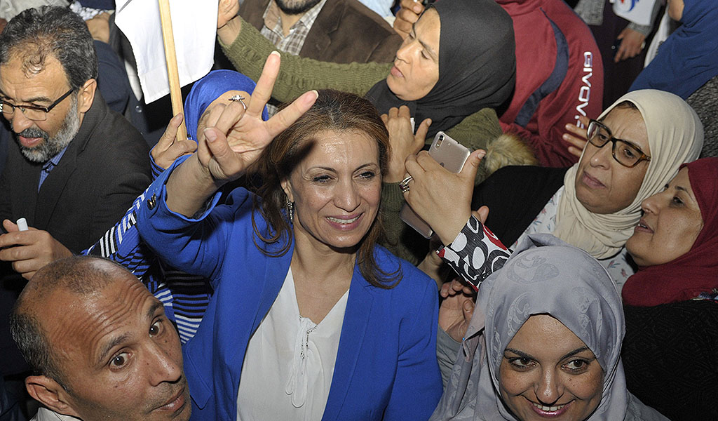 Tunisian Ennahdha party member Souad Abderrahim (C) jubilates after winning the municipal elections in front of the movement's headquarters in Tunis late on May 6, 2018. (Photo: SOFIENNE HAMDAOUI / AFP / Getty Images)