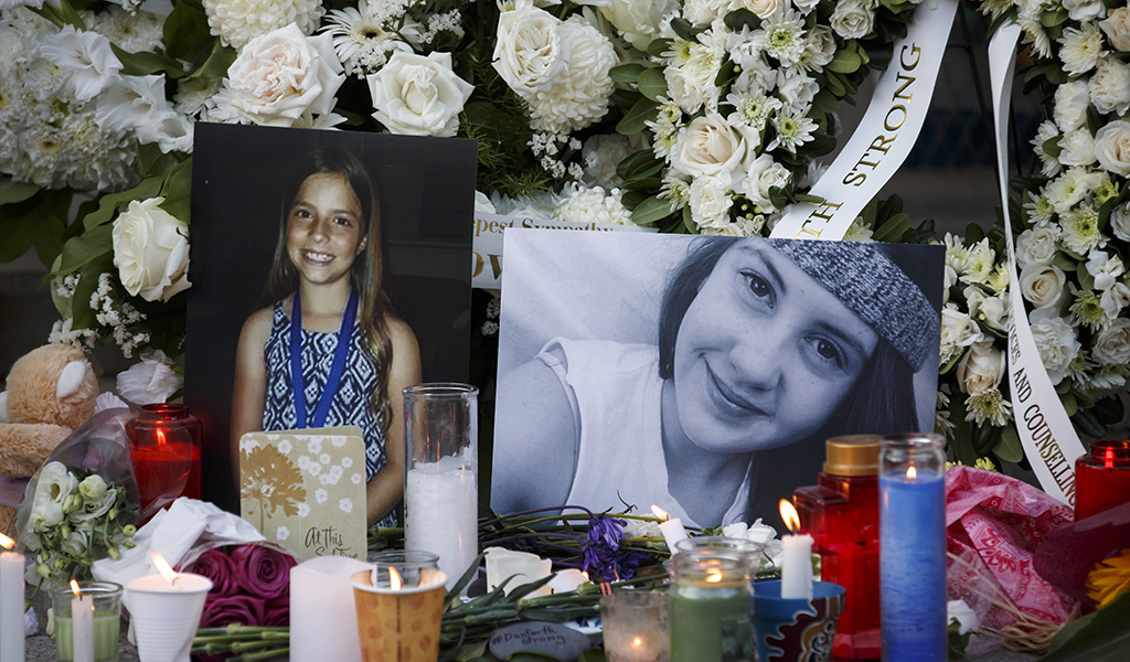 TORONTO, ON - JULY 25: Photos of victims Julianna Kozis, 10, left, and Reese Fallon, 18, are seen during a vigil for victims of Sunday night's mass shooting on Danforth Ave. on July 25, 2018 in Toronto, Canada. (Photo: Cole Burston / Getty Images)