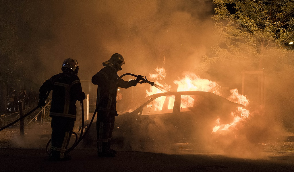 Firefighters work to put out a fire in a car in the Malakoff neighborhood of Nantes early on July 4, 2018. - Groups of young people clashed with police in the western French city of Nantes on the night of July 3 after a man was shot dead by an officer during a police check. Cars were burned and a shopping center partly set alight in the Breil neighborhood as police confronted young people, some armed with Molotov cocktails. (Photo: SEBASTIEN SALOM GOMIS / AFP / Getty Images)
