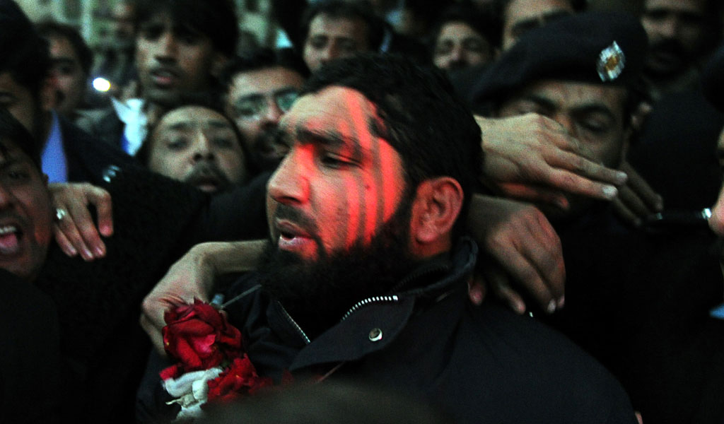 Mumtaz Qadri, a bodyguard who killed his boss Punjab State Governor Salman Taseer for supporting Asia Bibi, a Pakistani Christian woman accused of blasphemy. Qadri is surround by his supporters and feted with a garland of flowers. He has since become a hero in Pakistan. (Photo: AAMIR QURESHI/AFP/Getty Images)