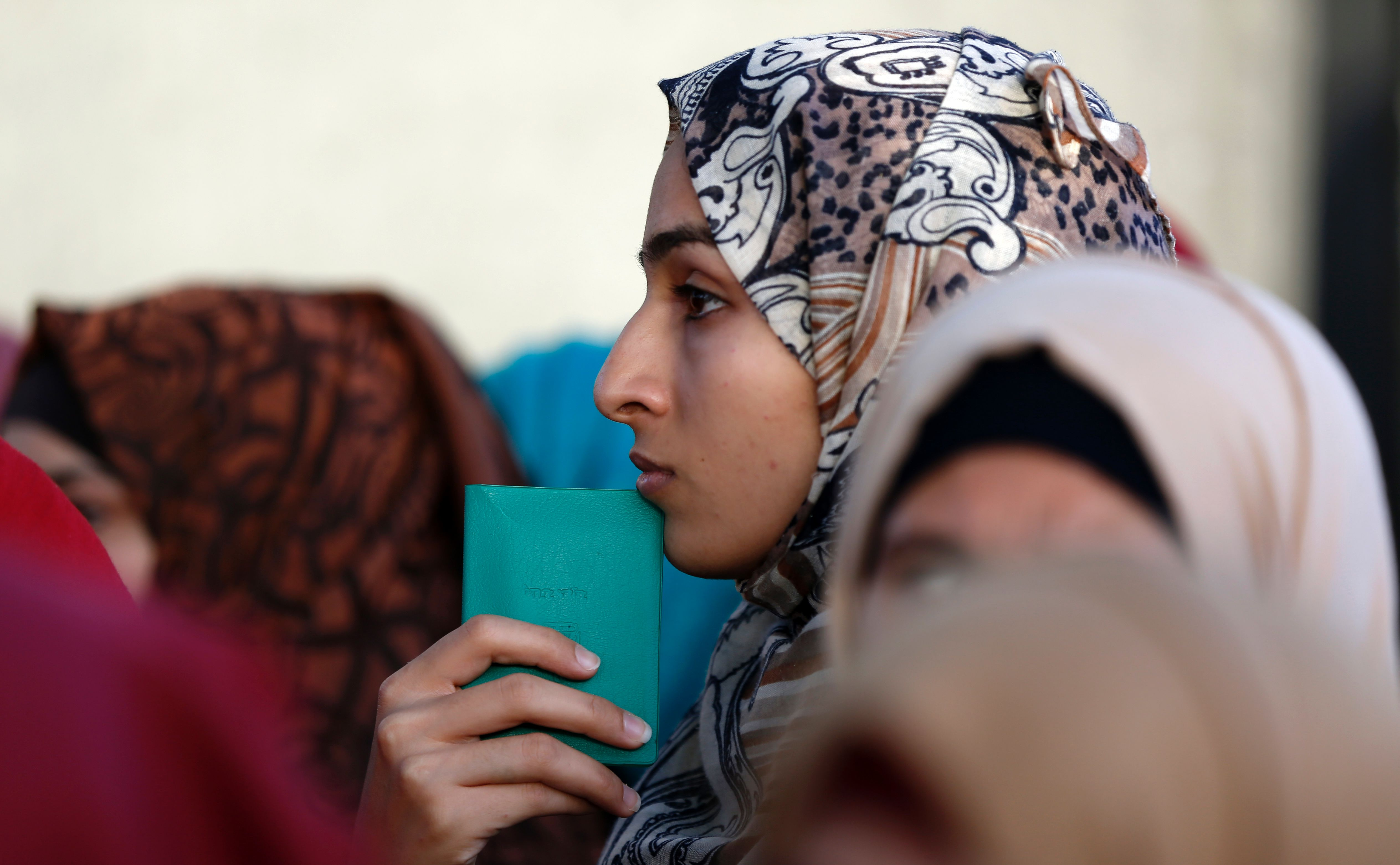 A Palestinian woman holds her identity card as she waits in queue at the Qalandia checkpoint in the occupied West Bank on June 9, 2017, in order to attend the second Friday prayers of the Muslim holy month of Ramadan at al-Aqsa mosque in Jerusalem. (Photo: ABBAS MOMANI / AFP / Getty Images) American Muslim Identity Muslim Reformers Islamic Reform