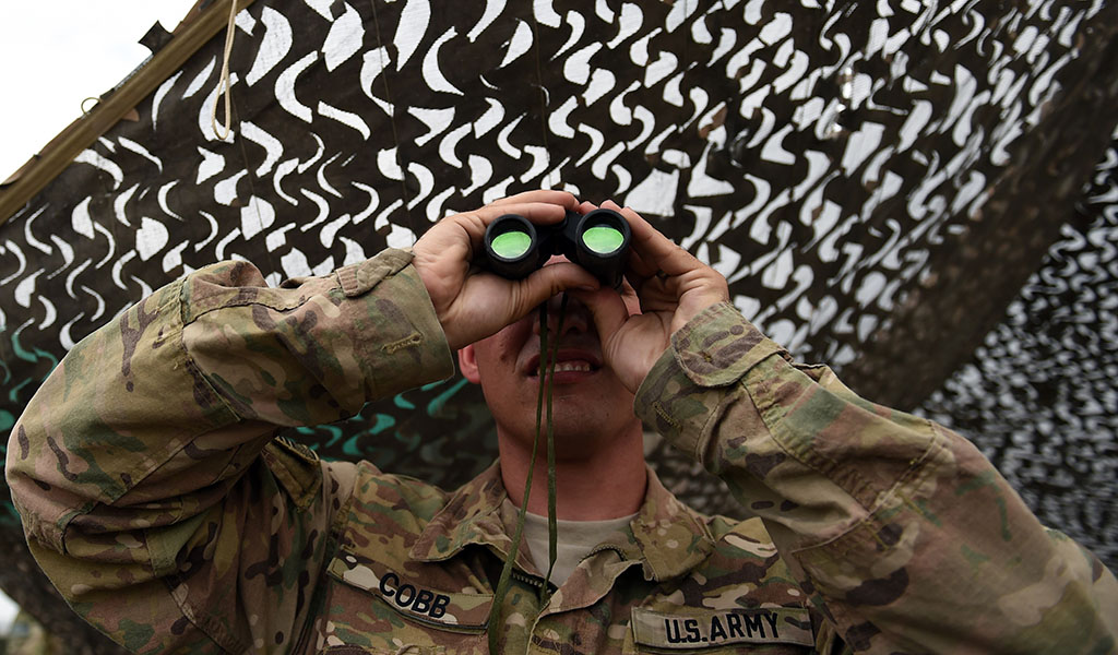 A US army soldier looks on with binoculars at Coalition forces Forward Operating Base (FOB) Connelly in Khogyani district in the eastern province of Nangarhar. (Photo: WAKIL KOHSAR / AFP / Getty Images)