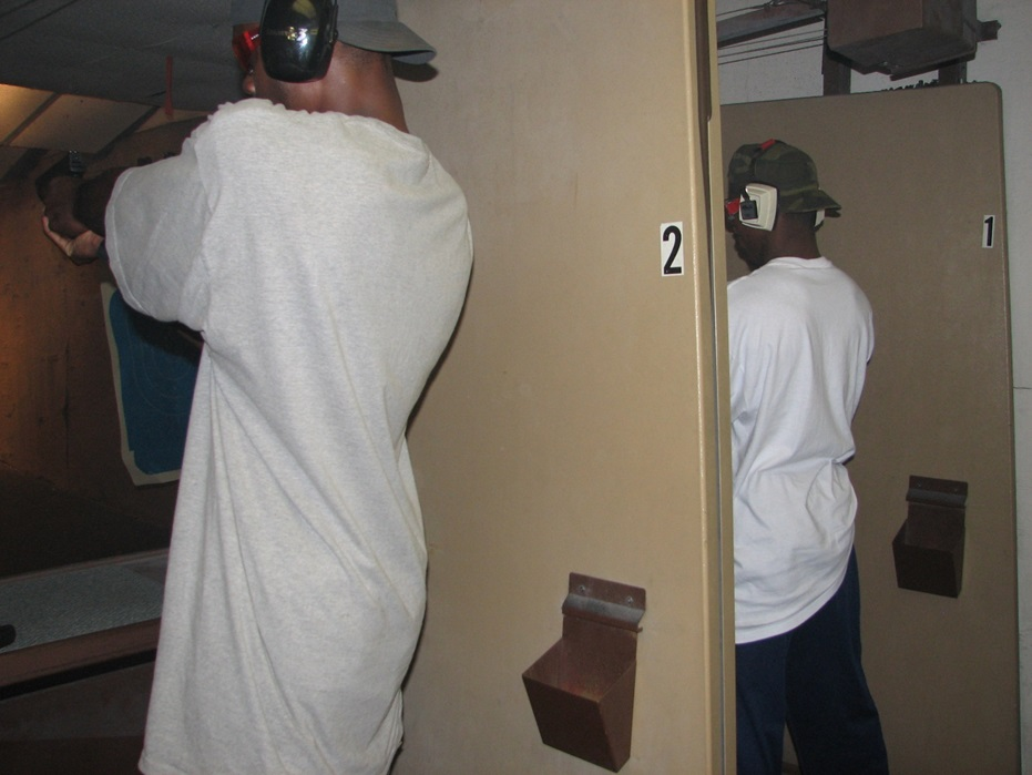 "Above: Ali Abelaziz (using the name Alaa Abdelaziz) provided intelligence to the U.S. government on his colleagues in Fuqra. Here, two of the chosen ""military squad"" members are at the firing range as part of the training they received in security-related duties, including instruction in counter-terrorism."