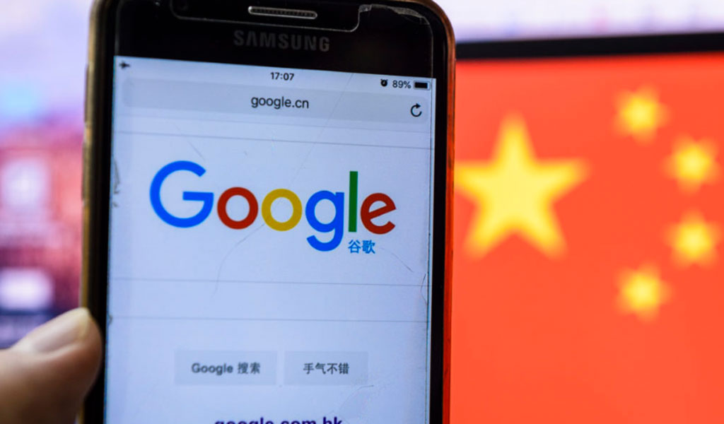 A smart phone with the Google search bar, and a Chinese flag in the background. (Photo: Marcio Rodrigo Machado /S3 Studio /Getty Images)