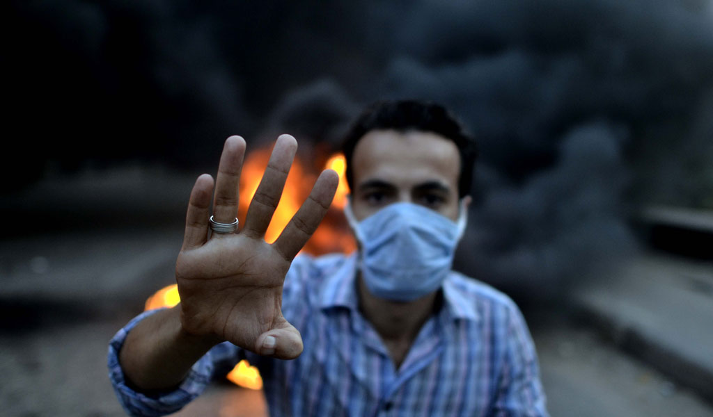 A Muslim Brotherhood supporter in Egypt clashes with police (Photo: MOHAMED EL-SHAHED/AFP/Getty Images)
