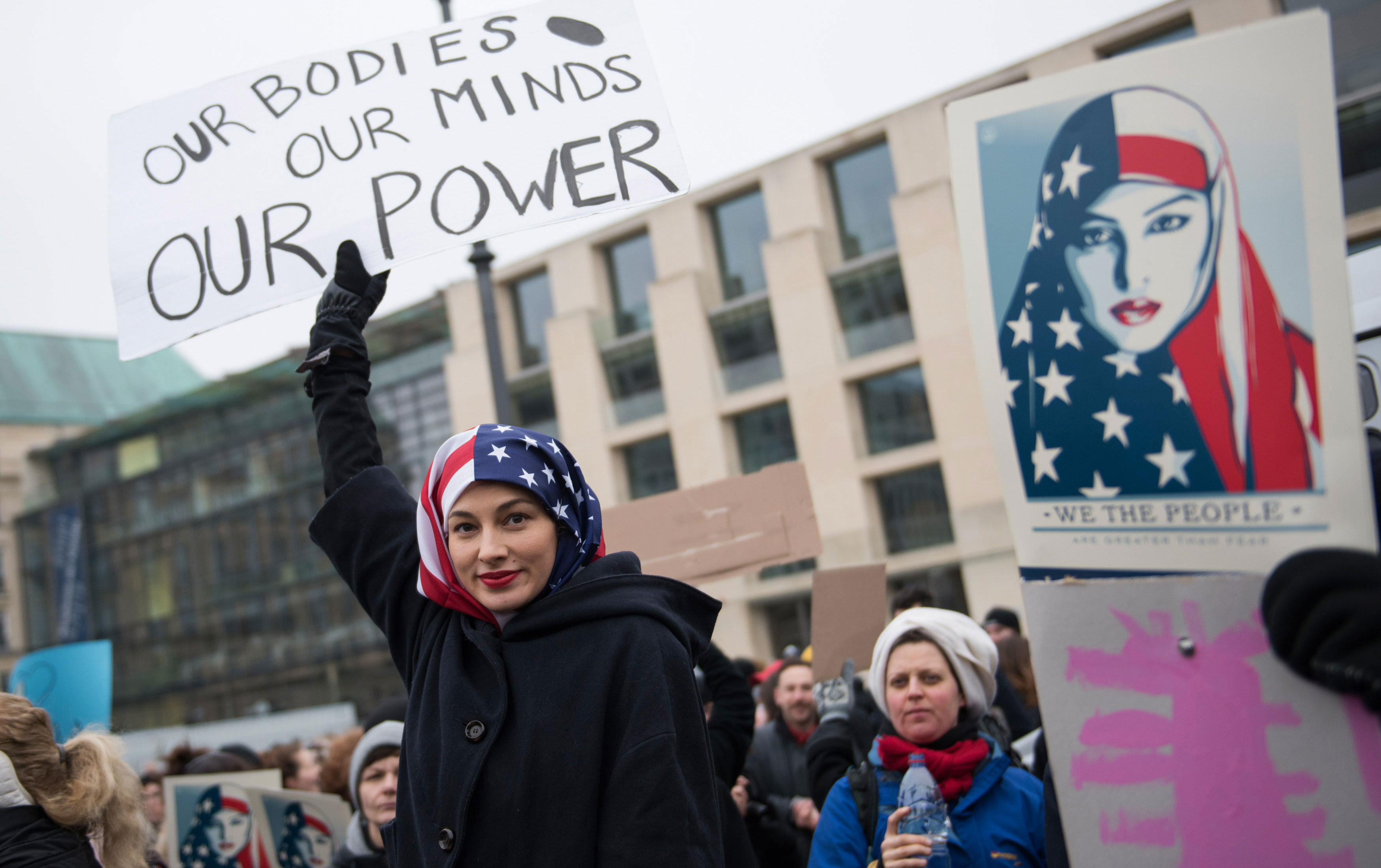 A woman wearing an American flag as a headscarf attends a protest for women's rights and freedom in solidarity with the Women's March on Washington in front of Brandenburger Tor on January 21, 2017 in Berlin, Germany (Photo: Steffi Loos / Getty Images)