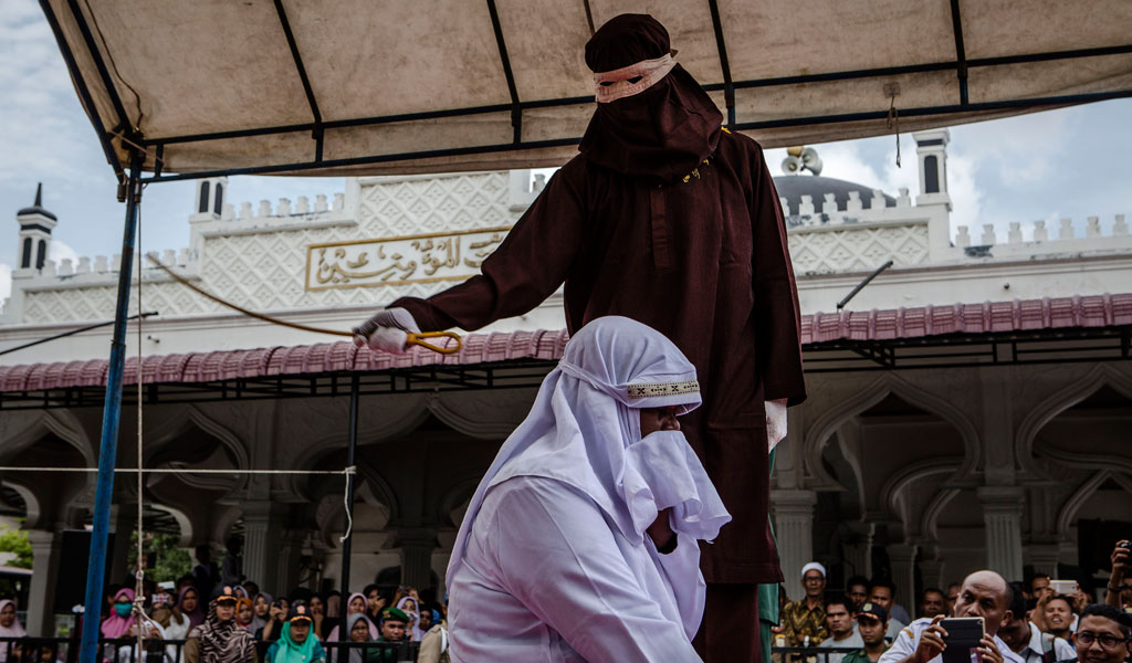 A woman is caned in the sharia-compliant province of Aceh in Indonesiafor spending time with a man who was not her husband (Photo: Ulet Ifansasti/Getty Images)