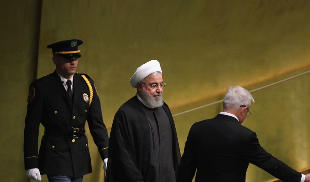 Iranian President Hassan Rouhani being escorted at the UN September 25, 2018 (Photo: John Moore/Getty Images)