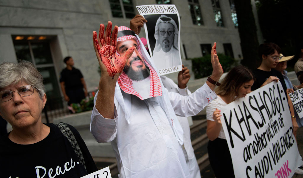 A protester dressed as Saudi Crown Prince Mohammed bin Salman decries the murder of Saudi journalist Jamal Khashoggi believed to be at the hands of the Saudi government (Photo: JIM WATSON/AFP/Getty Images)