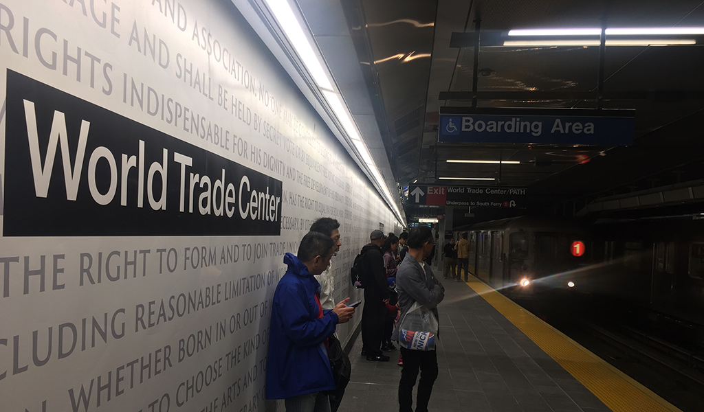"People await the arrival of the underground train at the World Trade Center - Cortlandt Street subway station in New York, September 9, 2018, where just days before the anniversary of the September 11 attacks, trains are once again running through subway station buried when the Twin Towers fell 17 years ago. - The Cortlandt stop reopened on Saturday on the Number One line in what The New York Times described as ""the last major piece in the city's quest to rebuild what was lost."" The station was under the World Trade Center, whose twin towers collapsed in flames after being struck by airliners commandeered by al-Qaeda terrorists. (Photo: THOMAS URBAIN / AFP / Getty Images)"