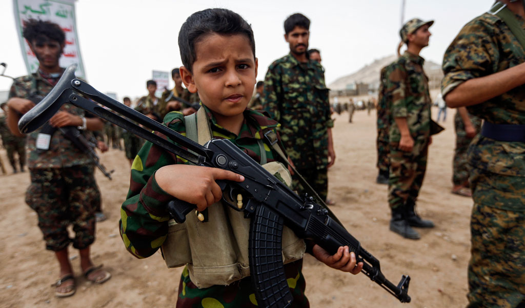 A child soldier in Yemen fighting for the Iranian-backed Houthis sports a Kalashnikov (Photo: MOHAMMED HUWAIS/AFP/Getty Images)