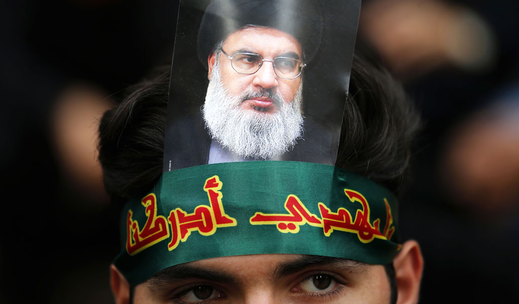 A Hebollah supporter in Beruit wears a picture of the terror group's leader, Hasan Nasrallah (Photo: ANWAR AMRO/AFP/Getty Images)