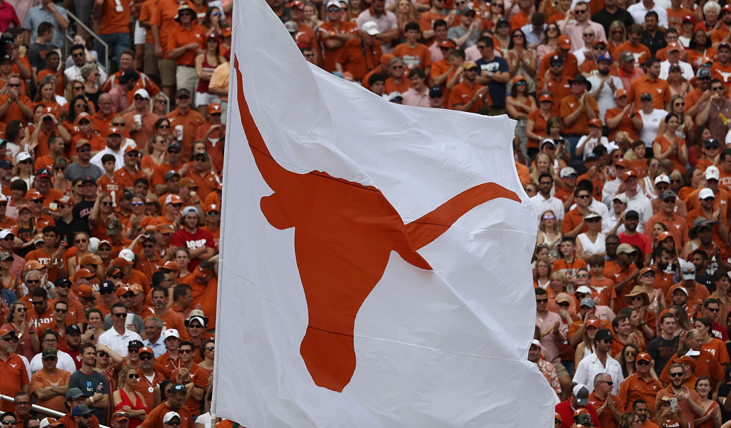 A Texas Longhorn flag flies at Texas-Oklahoma game in Dallas in October 2018 (Photo: Ronald Martinez/Getty Images)
