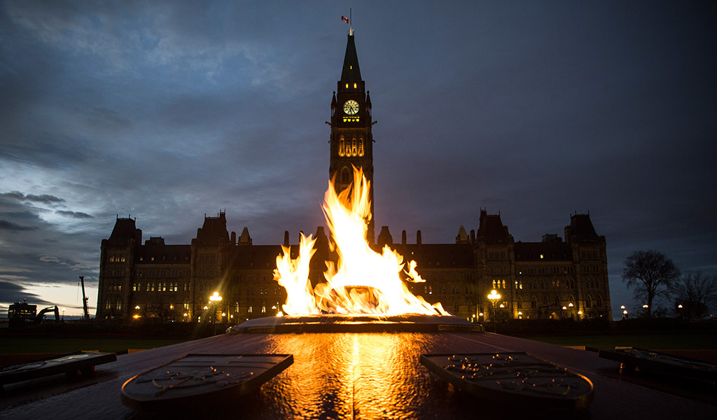 The Canadian Parliament building in Ottawa with the National War Memorial in the foreground. (Photo: Andrew Burton / Getty Images)