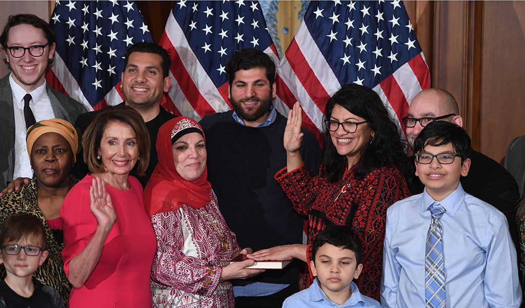 US House Representative Rashida Tlaib (D-MI), (third from right with hand raised) participates in a ceremonial swearing-in from Speaker of the House Nancy Pelosi (D-CA) at the start of the 116th Congress at the US Capitol in Washington, DC, January 3, 2019. (Photo: SAUL LOEB / AFP / Getty Images)