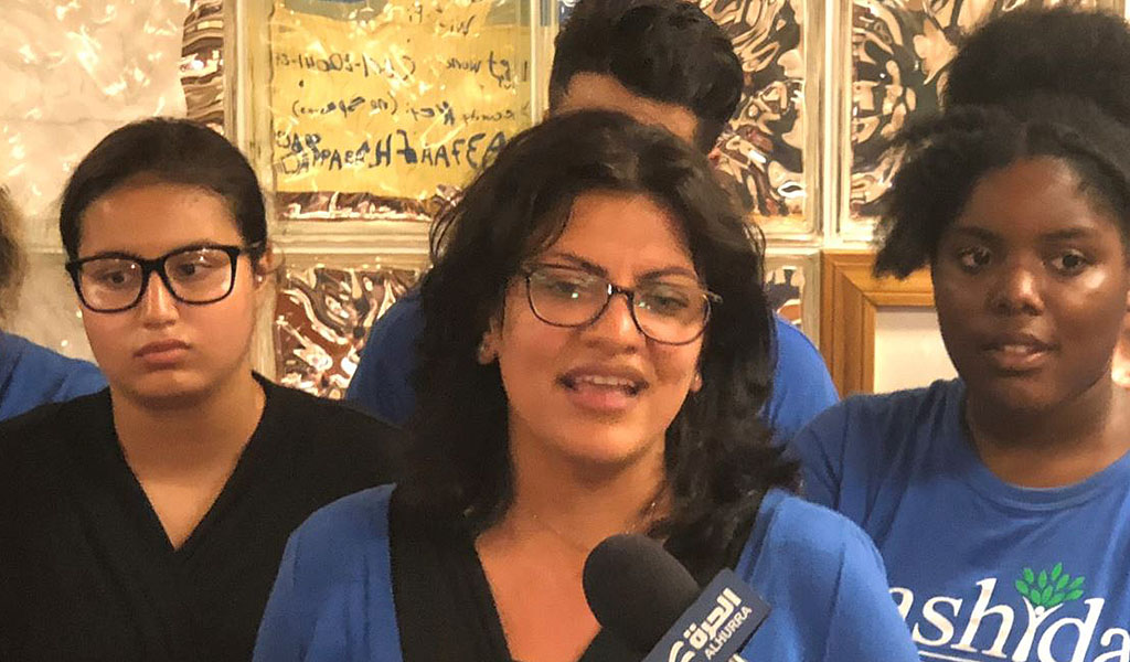 Rashida Tlaib at her campaign headquarters in Detroit, Michigan, August 7 2018. (Photo VOA / Flickr - https://www.voanews.com/a/palestinian-american-congressional-candidate-source-of-west-bank-pride/4519493.html)