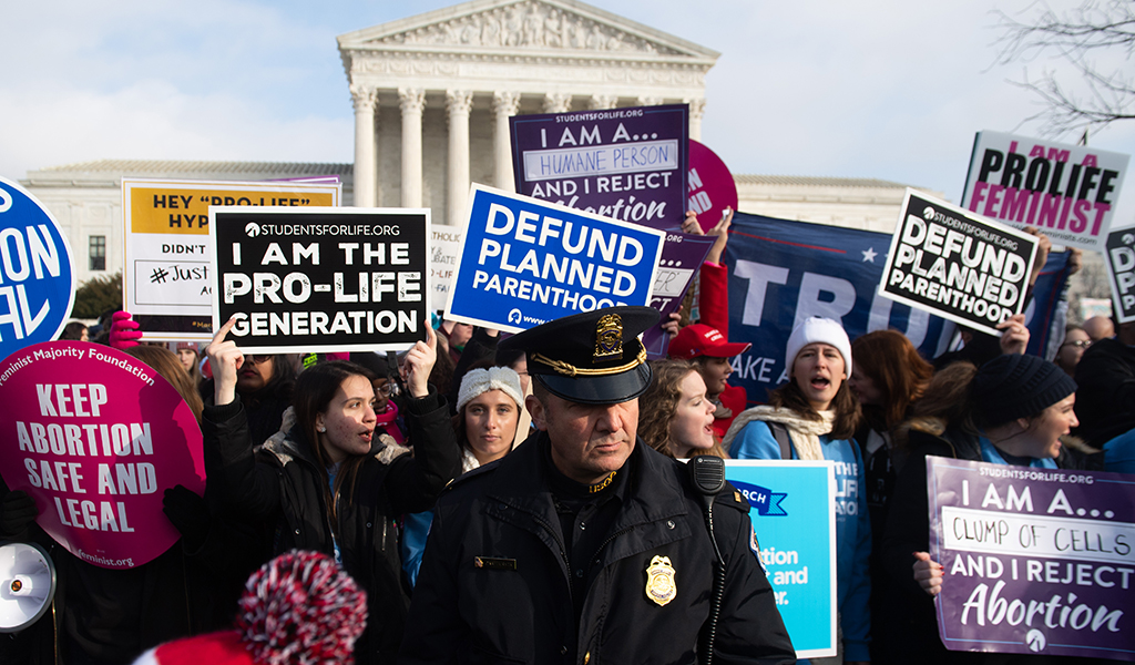 Anti-abortion activists participate in the March for Life, an annual event to mark the anniversary of the 1973 Supreme Court case Roe v. Wade, which legalized abortion in the US, outside the US Supreme Court in Washington, DC, January 18, 2019. (Photo: SAUL LOEB / AFP / Getty Images)