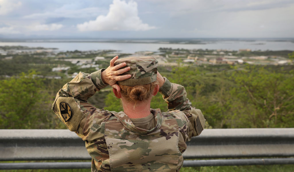 A US soldier looks at a naval station at Guantanamo Bay, Cuba (Photo:John Moore/Getty Images)