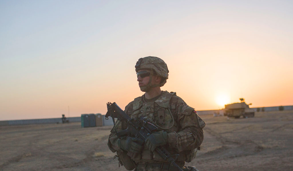 A US soldier stands at the Qayyarah military base during the ongoing operation to recapture the last major Iraqi city under the control of the Islamic State (IS) group jihadists in October 2016 (Photo: YASIN AKGUL/AFP/Getty Images)