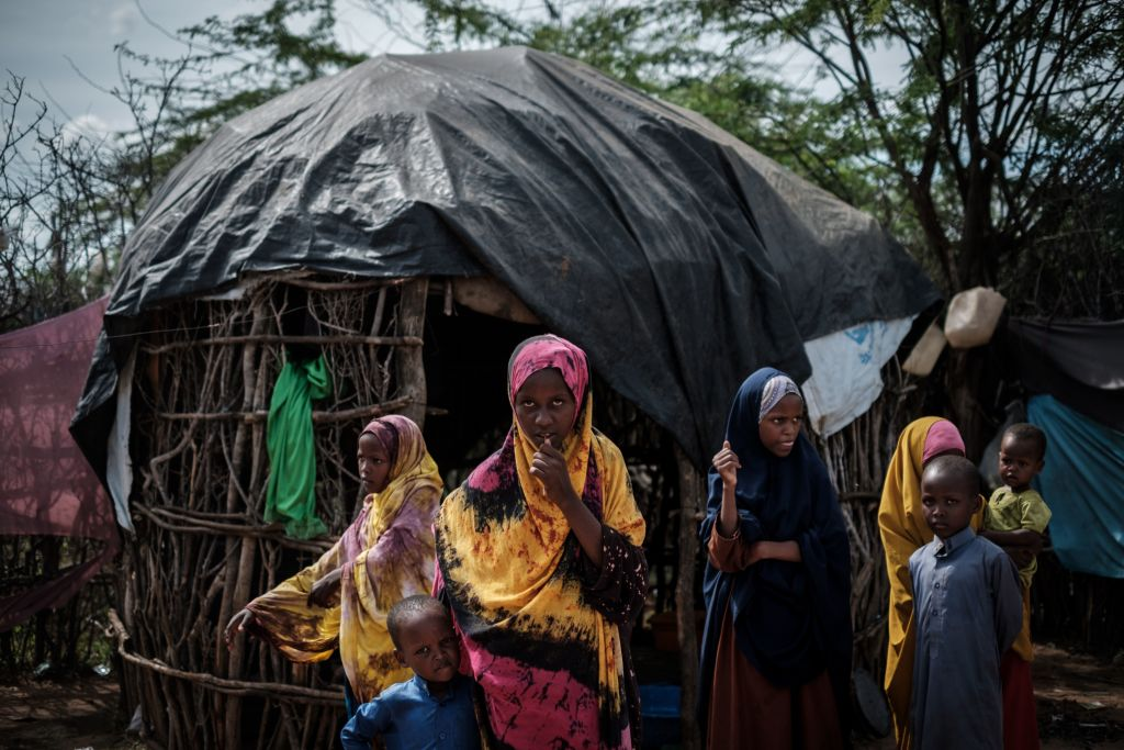Somali refugee children stand at Dadaab refugee camp complex, in Kenya. (Photo: Yasuyoshi Chiba / AFP / Getty Images) CHIBA / AFP) (Photo credit should read YASUYOSHI CHIBA/AFP/Getty Images)